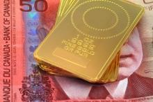 Onces d'or disposées sur un billet de 50$ canadien. Photo: Thinkstock.com